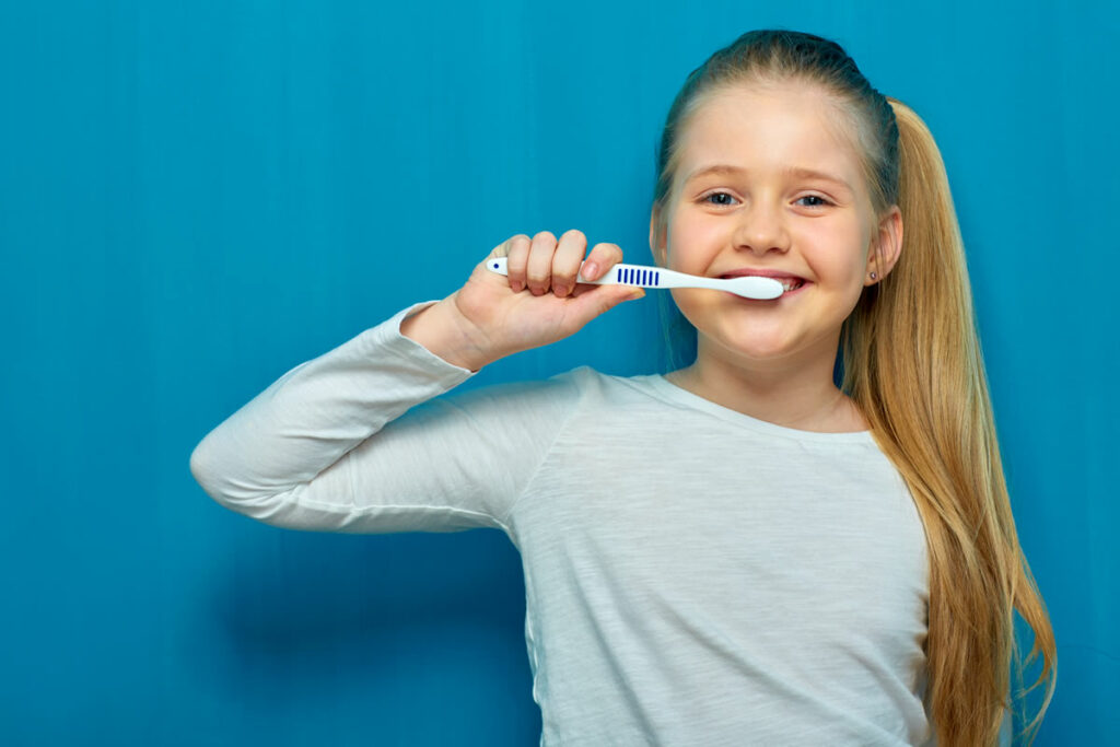 Girl Cleaning Teeth